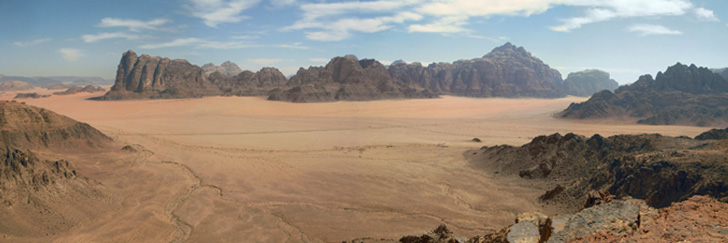 Ibex Canyon Lookout - The Seven Pillars of Wisdom in the Distance in Wadi Rum - Hiking in Jordan.